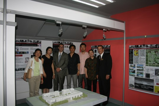 Faculty and Administrators from Beijing University tour student exhibits Professor Kaiser