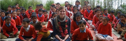 Katie with students in India